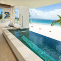 Open room with a pool with a beach view